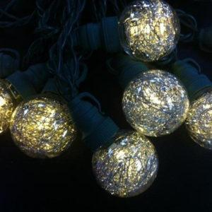 Warm white globe LED string light with tinsel